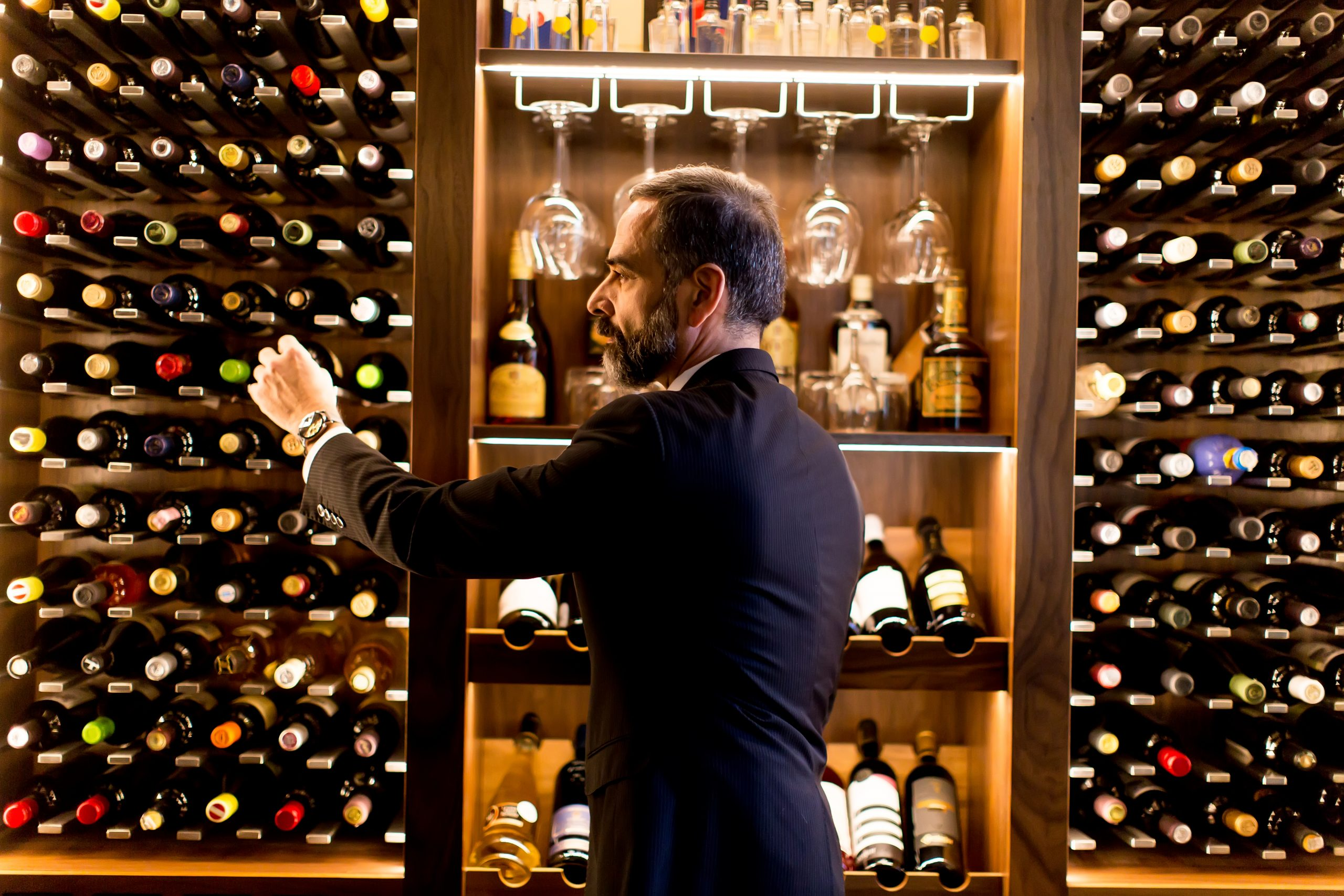Sommelier chooses a bottle of wine